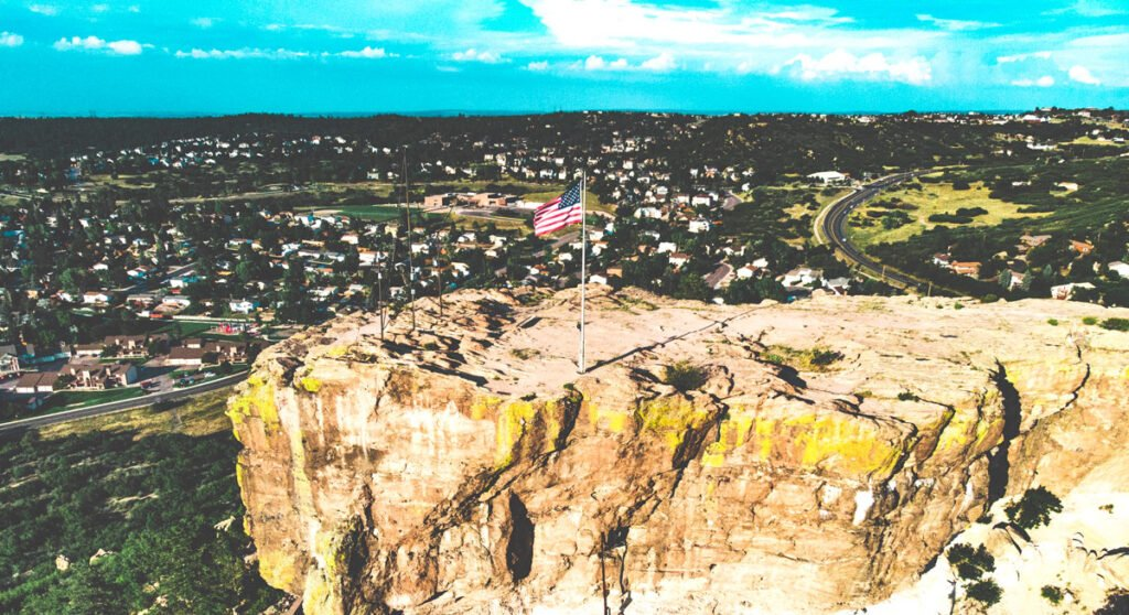 Aerial view of the Castle Rock with the flag the United States