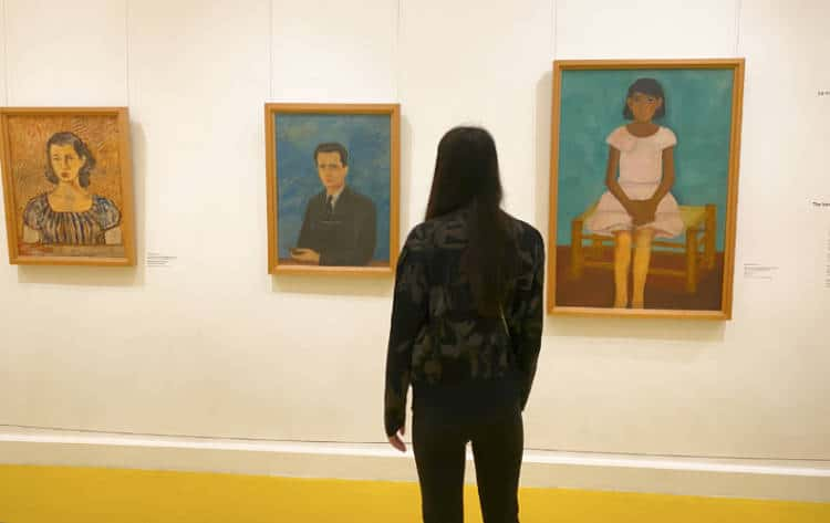 Woman viewing paintings at the Frida Kahlo Museum