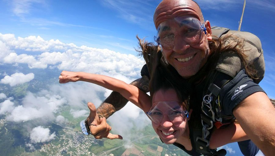 View of the author of Best Things to Do in Puerto Rico and a man enjoying skydiving