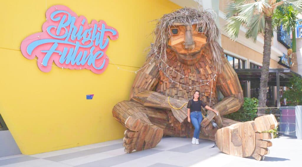 The author in front of the Bright Future troll, one of the top things to do in San Juan