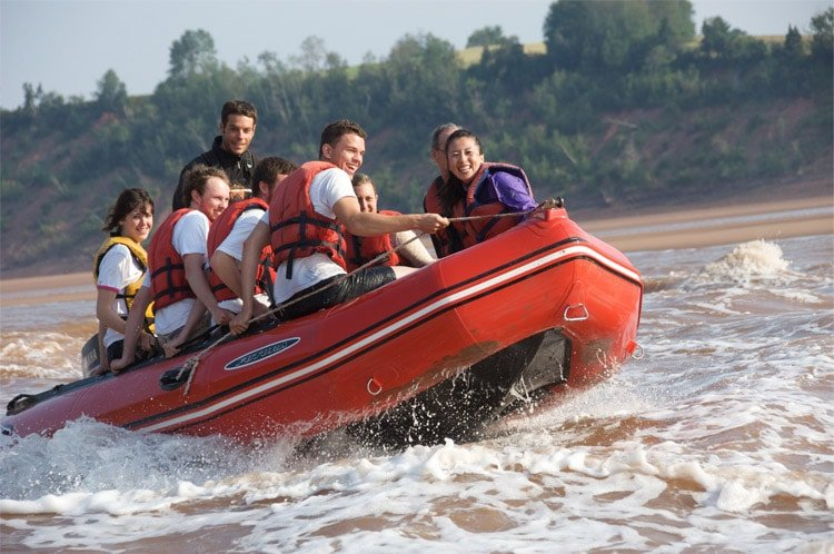 several people in a raft enjoying tidal bore rafting