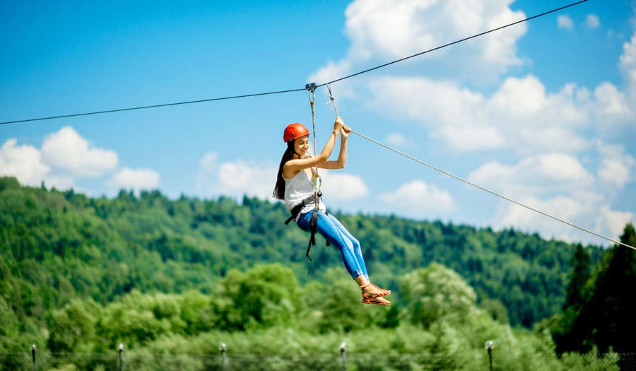 View of a woman riding on a zipline