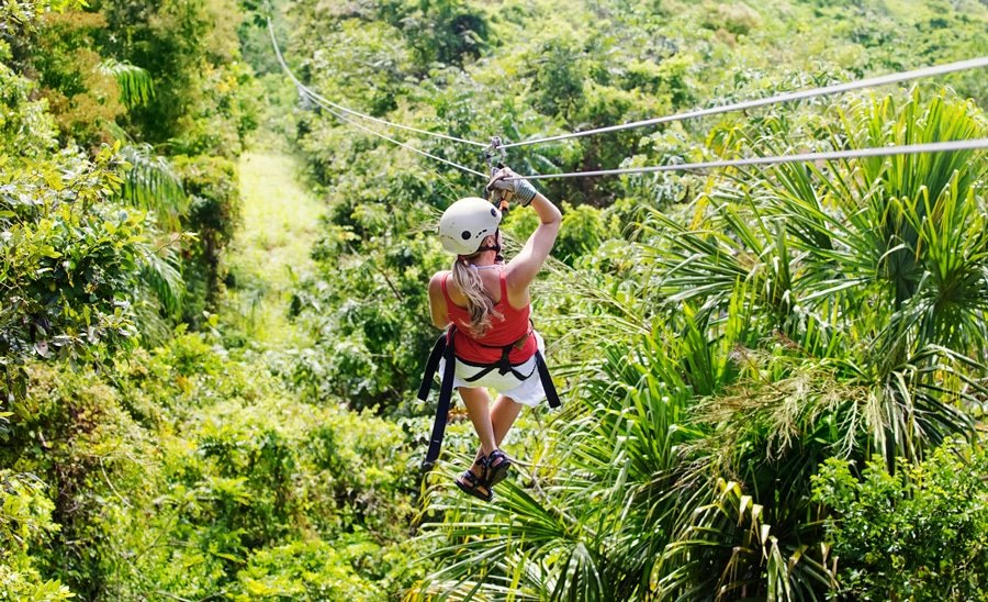 View of a woman going on a zipline adventure in Toro Verde Nature Adventure Park