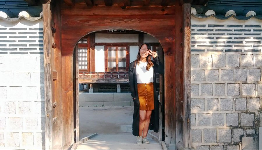 View of the author in front of a traditional house in South Korea