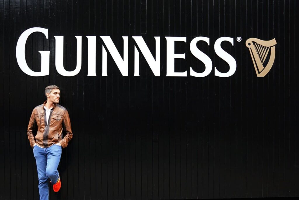 A man against the Guinness sign in Dublin
