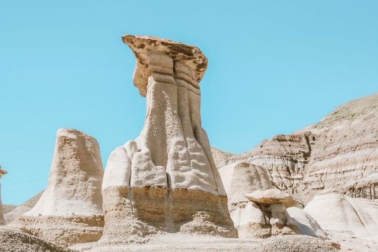 Hoodoos in Drumheller, Canada surrounded by rock and blue sky
