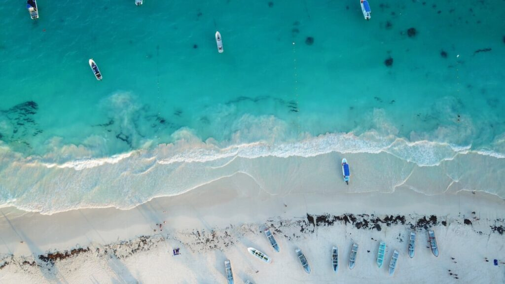 Drone photo of boats on Tulum beach