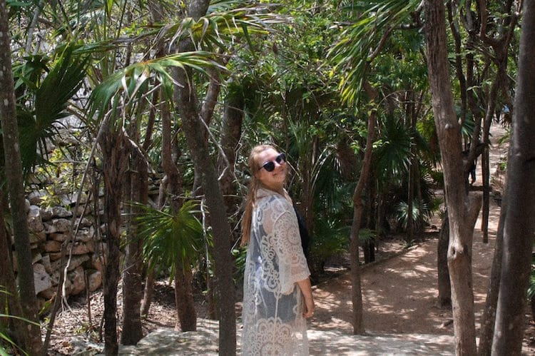Taylor standing among jungle at the Tulum Ruins in the Riviera Maya region of Mexico