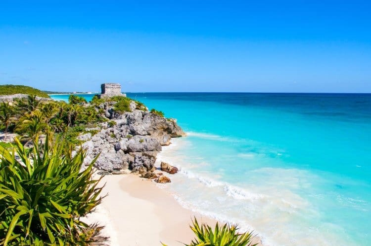 A colorful view of the Tulum Ruins set against the Caribbean Sea in Quintana Roo, Mexico