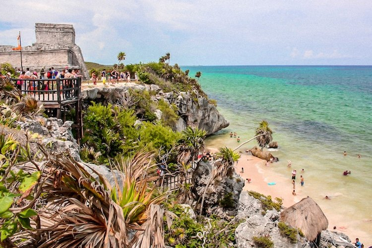 People swim in the ocean near the Tulum Ruins in Riviera Maya Mexico