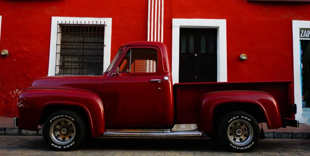 Truck against red wall in Valladolid Mexico