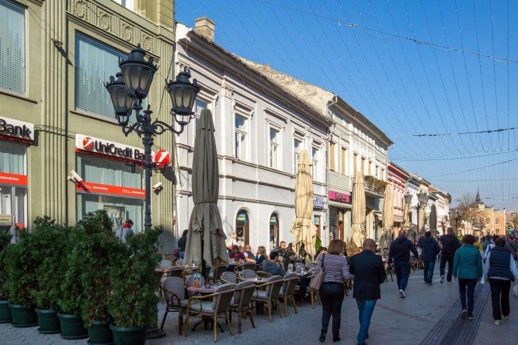 People walking streets of Zmaj Jovina in Novia Sad Serbia
