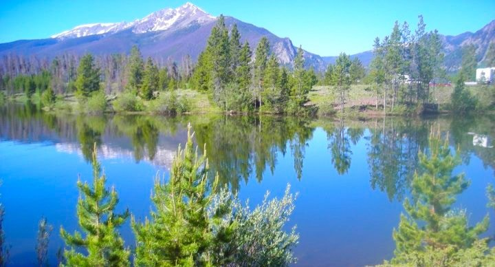 View of Rocky Mountains against a lake in Frisco, Colorado