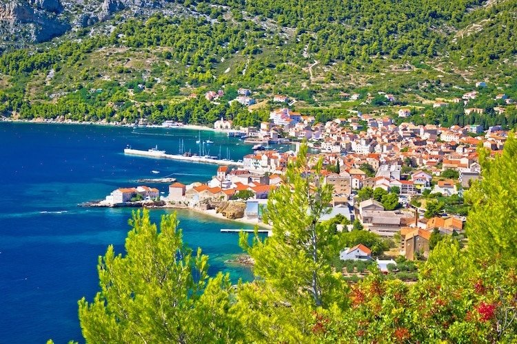 The town of Vis is surrounded by dense forest and the azure Adriatic Sea
