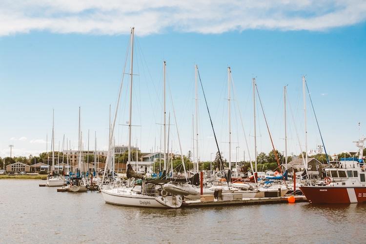 Boats rest in the Gimli, Manitoba harbor in summertime