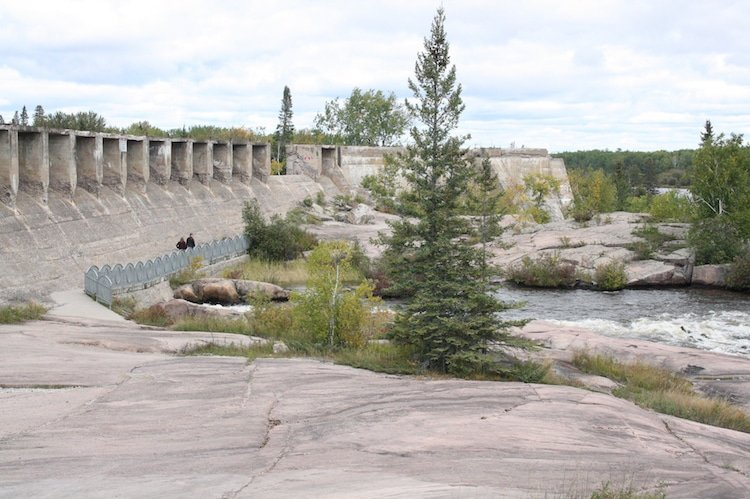 Pinawa Dam Provincial Park in Manitoba, with trees, rushing water, and rocky terrain
