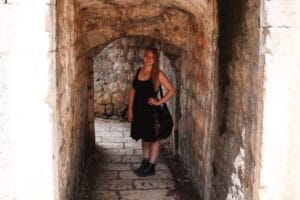 Taylor stands among old stone walls in Dubrovnik, Croatia
