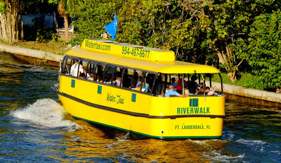 View of people having a tour while riding a water taxi