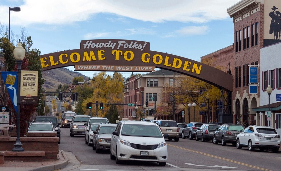 View of the main street in Golden Colorado and its welcoming sign