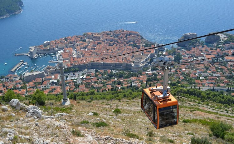 Taking the cable car up the mountain in Dubrvonike Croatia, with the old town below