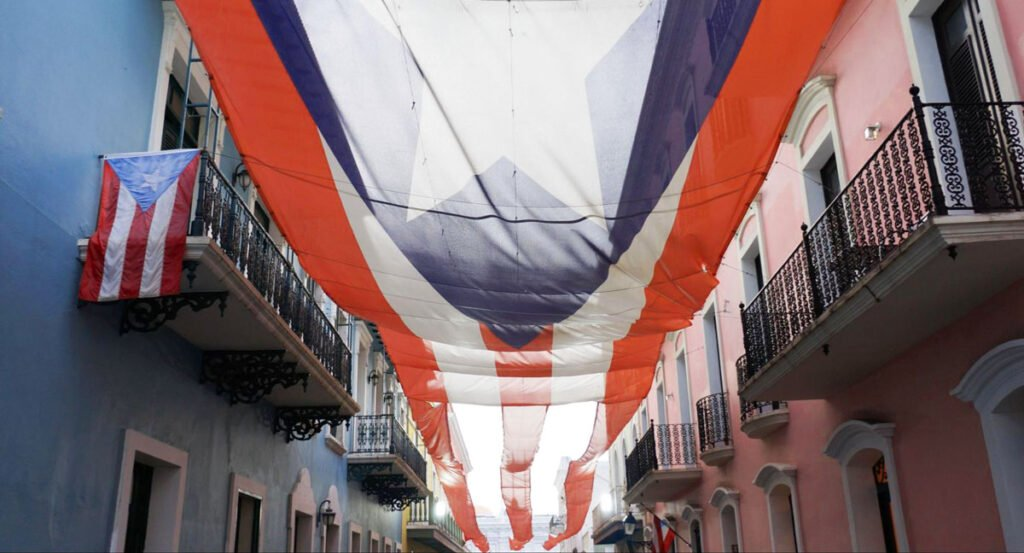 View of the flag of Puerto Rico in the middle of colorful houses