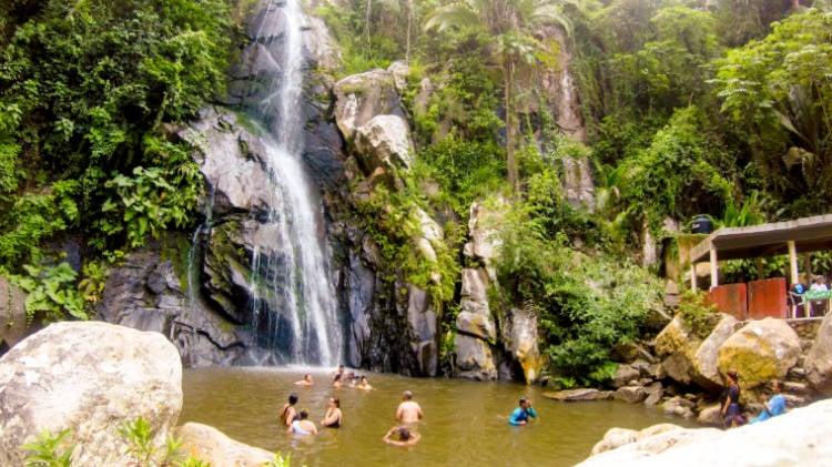 People enjoying the waterfall in Yelapa, Puerto Vallarta.