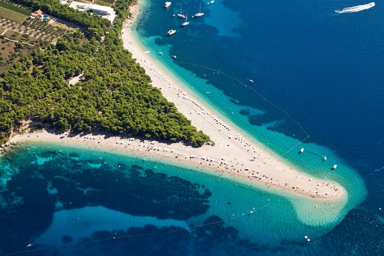 An aerial shot of Zlatni Rat Beach near Bol on Brac Island