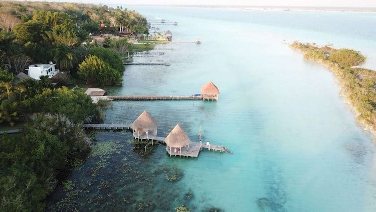 Overhead shot of shelters on the water in Bacalar Mexico