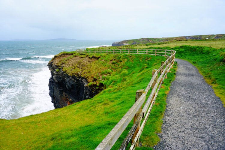 Green cliffs high atop the sea in Ireland.