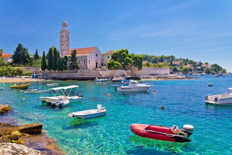 Turquoise sea of Hvar island, franciscian monastery view in Dalmatia, Croatia