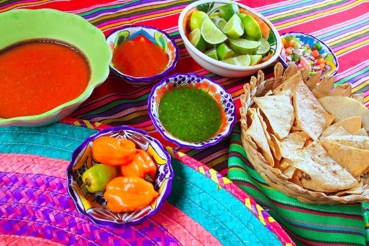 A colorful taco spread with chips and salsa