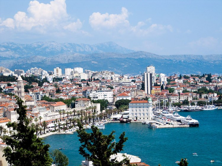 Aerial view of downtown split, the mountains, and the adriatic sea.