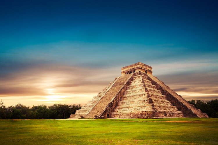 Ancient pyramid of Chichen Itza at osunset