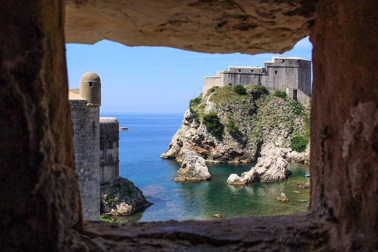 A view of the Dubrovnik fortress and the Adriatic sea through a gap in the old town walls