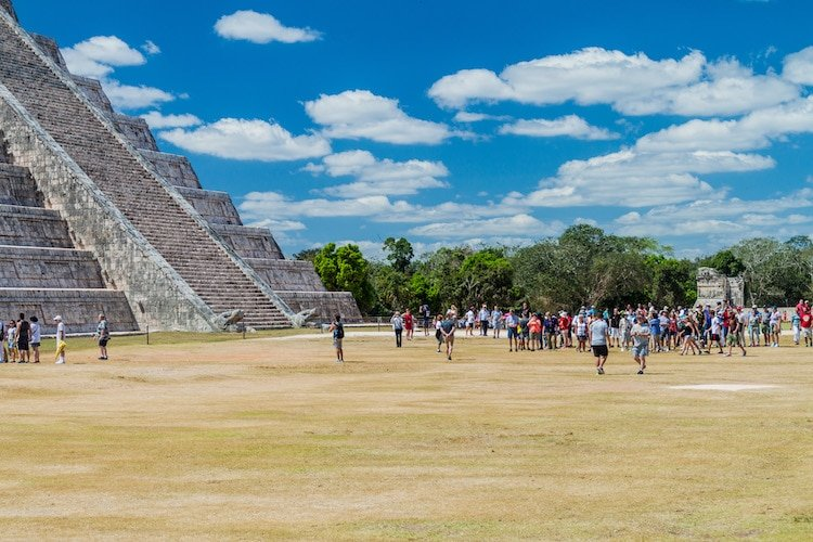 Crowds of tourists visit the Kukulkan pyramid at the archeological site Chichén Itzá