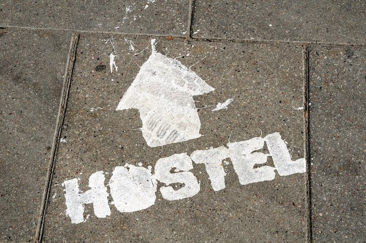 hostel sign with arrow showing direction