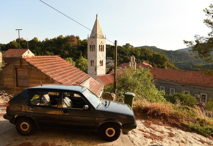 Old black car on mediterranean island