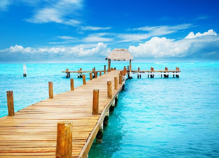 Vacation in Tropic Paradise. Jetty over blue waters in on Isla Mujeres, Mexico
