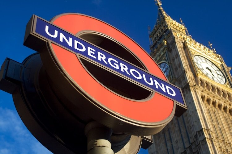 A London Underground sign outside The Houses of Parliament in the UK.