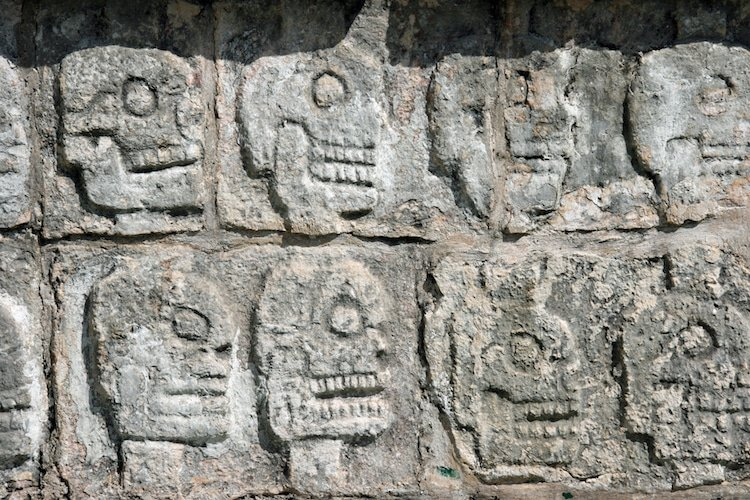 Stone carvings of skulls at Chichen Itza, Mexico