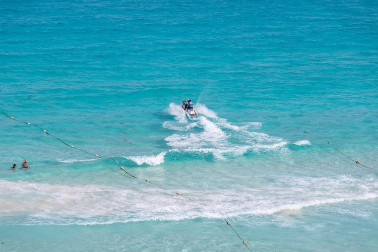 People jetskiing on turquoise waters in Playa del Carmen, Mexico