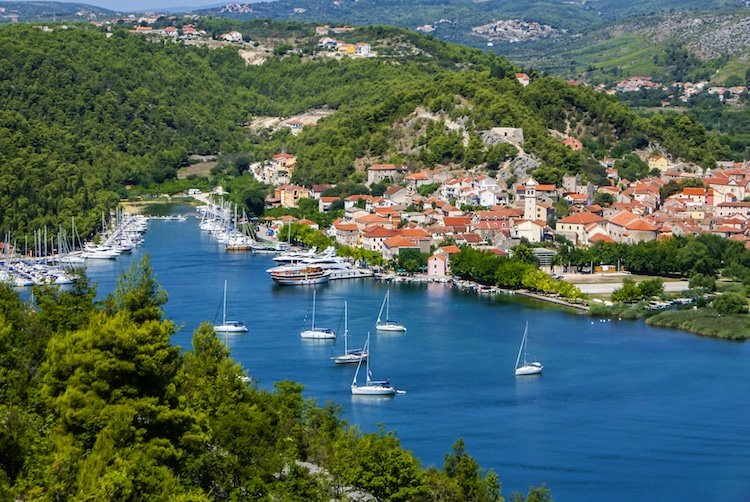 Sail boats rest in the harbor off a small town in Croatia