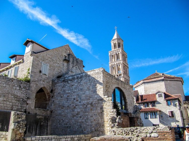 Downtown Split, Croatia with a view of the bell tower and old brick buildings.