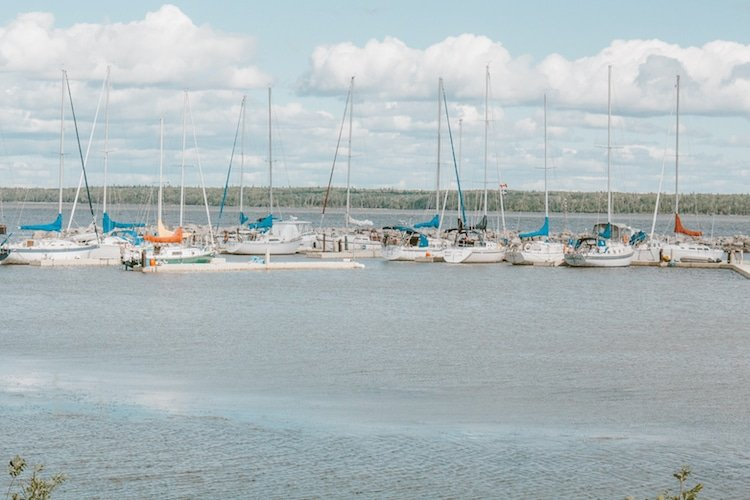 Sailboats are docked in the harbour of Gimli, Manitoba