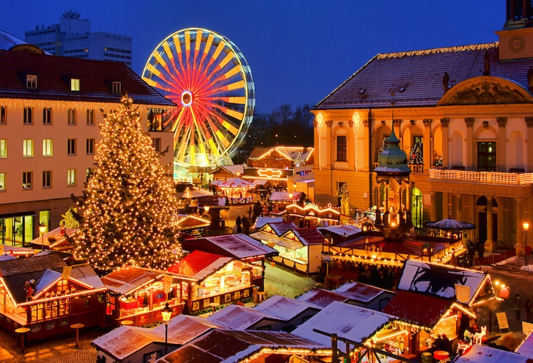 Magdeburg christmas market in Germany at night. With ferris wheel and Christmas tree.