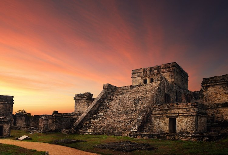 The sun sets over the Tulum Ruins in Tulum, Mexico