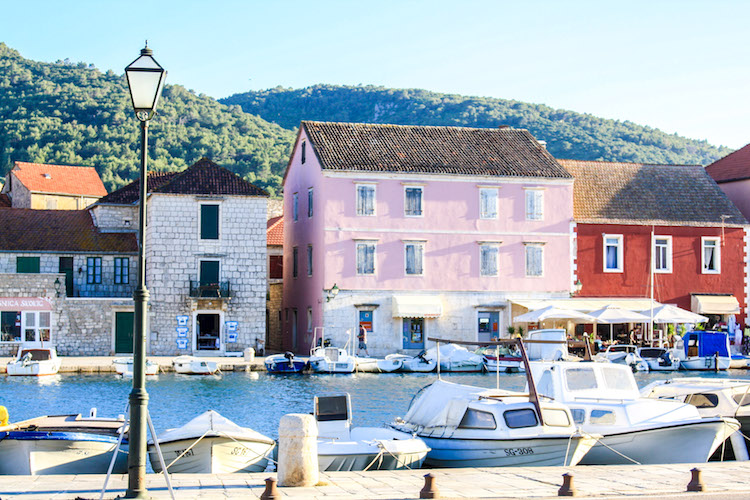 Colorful buildings line the promenade in Stari Grad, Hvar, Croatia
