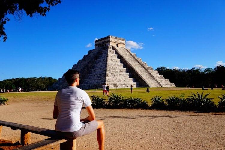 Nate Hake sitting in front of Mayan ruins